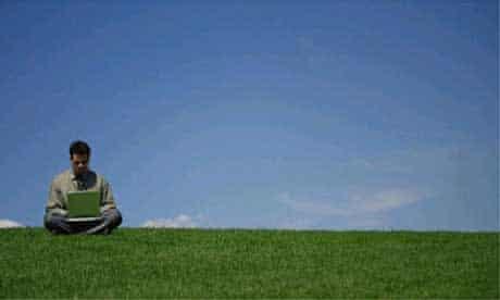 Laptop user in a field