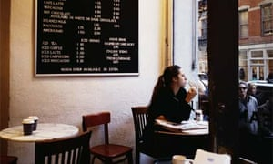 Woman eating alone in a cafe