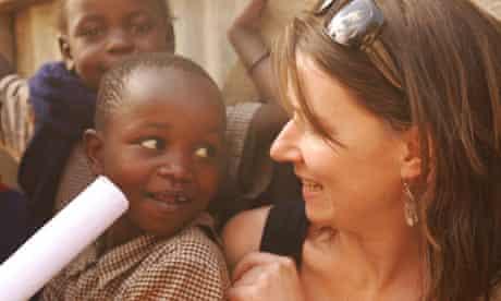A gapper plays with a Kenyan child