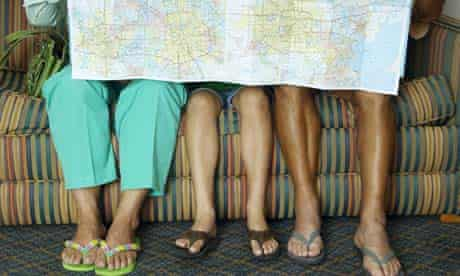 Family on a couch with a holiday map