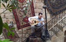 A local man plays the oud in the old city of Aleppo, Syria