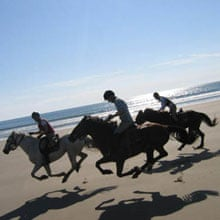 Beach gallop pony trek. Photograph: Trans Wales Trails