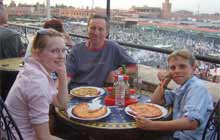 Family eating in Jmaa el Fna square, Marrakech