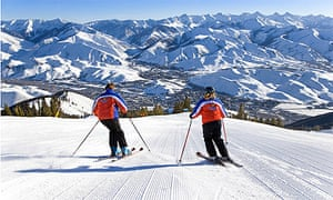 Ski instructors skiing down Bald Mountain in Sun Valley, US