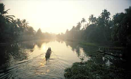 Canoeists on one of Kerala's canals