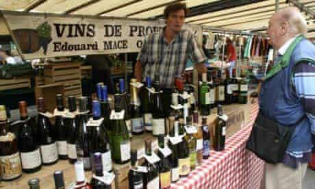Selling wine at Marché Richard Lenoir in Paris.