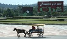 A horse-drawn 'taxi' crosses the parade ground at the Che Guevara memorial in Santa Clara