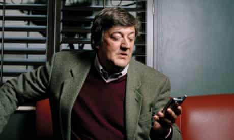 Stephen Fry on his mobile