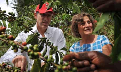 Starbucks CEO Howard Shultz and Harriet Lamb visit coffee farmers in Musasa, Rwanda