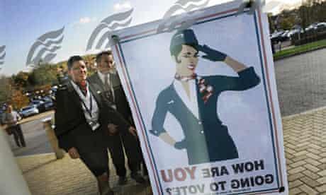 British Airways cabin crew look at a strike poster