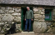 Charlie Troy in doorway of a restored cottage at Cnoc Suain, Connemara