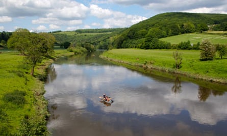 Family Canoeing on River Wye at Brockweir, UK