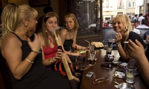 Women smoke water pipes at an Istanbul cafe, Turkey