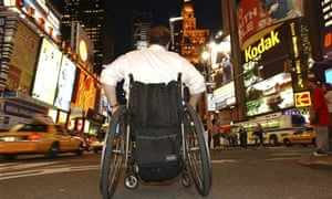 Man in a wheelchair crossing Times Square, New York