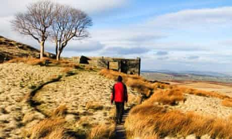 Walker on The Bronte Way at Top Withins, Haworth Moor, West Yorkshire