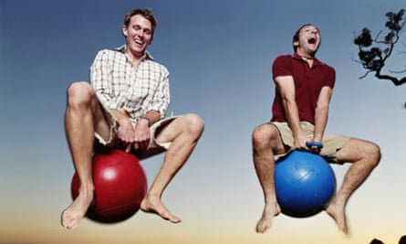 Two men on 'Spacehoppers'