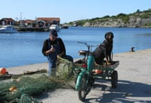 Fisherman with his 'flakmoppe' motor tricycle, Koster Islands, Sweden