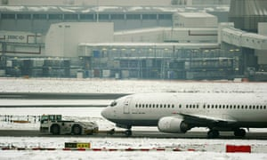 A grounded aircraft in snow at Heathrow