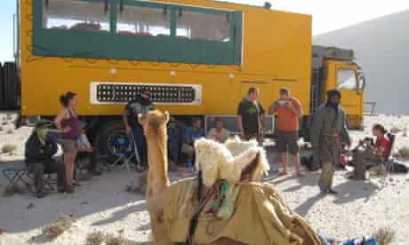 Camel and truck in Libya desert