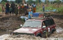 Jeep crossing river, western Tanzania