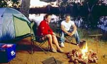 Couple cooking by a campsite