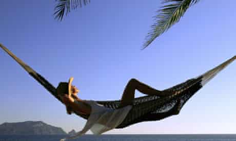 Woman relaxing in a hammock on holiday