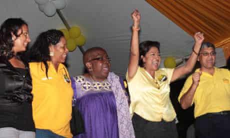 Trinidad and Tobago's prime minister Kamla Persad-Bissessar celebrates election victory