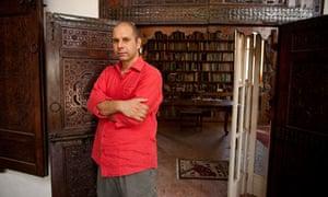 Tahir Shah at the entrance of the library in his house, Dar Khalifa.