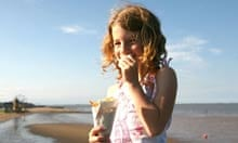 Girl eating fish and chips at Cleethorpes beach, Lincolnshire