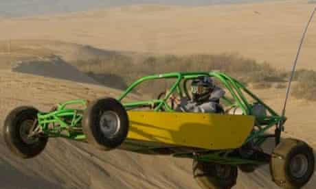 Racing a dune buggy in the desert