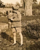 A rare photograph of Christopher Robin with the original Pooh bear.