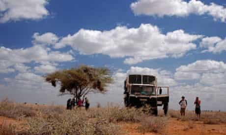 An overland vehicle travelling around the dry and arid land of Northern Kenya, Africa