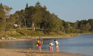 Family on the beach at Iluka, New South Wales