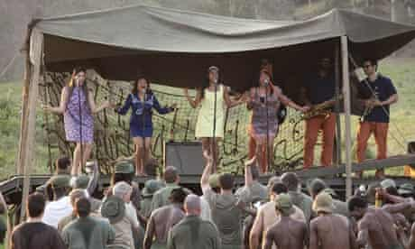 A scene from the Australian film The Sapphires, portraying the girls entertaining troops.