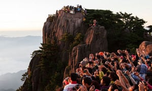 Tourists watching sunrise at Mt. Huangshan, Anhui
