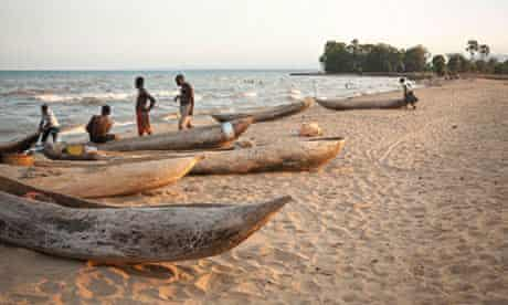 Traditional dugout canoes on the shore of Lake Malawi