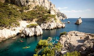 Kayakers in Les Calanques near Cassis, France.