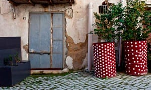 Red and white polka dots in back street