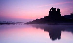 Sunrise over Ogmore Castle