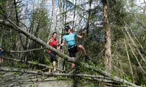 Susan, in the red top, tackles one of the obstacles on the trail