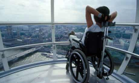 Disabled tourist enjoys the view from the London Eye