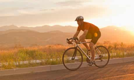 Man riding bicycle on remote road