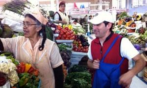 Andrés Dávila shopping in Quito's San Roque market.