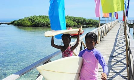 Young surfers at Cloud Nine surf point, Siargao, Philippines