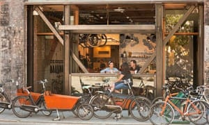 People sitting at counter in bicycle shop