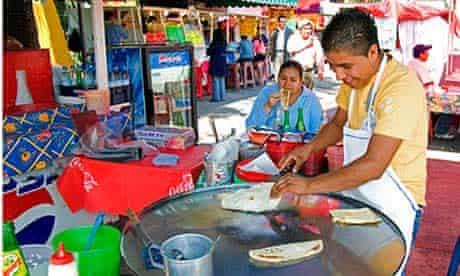 Food vendor making quesadillas in Mexico City