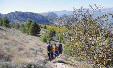 Hikers in El Comtat, a region of medieval villages