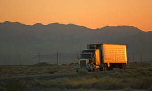 18-wheeler semi-trucks at sunset hit the highway driving down Interstate Highway 15
