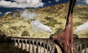 Jacobite steam train crossing Glenfinnan Viaduct