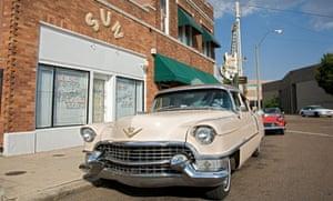 American Dream Safari's Cadillac Coupe De Ville parked in front of Sun Studio
